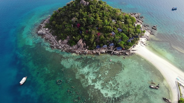 Turquoise sea near tropical island koh tao, small paradise. drone view, green jungle on sunny day.