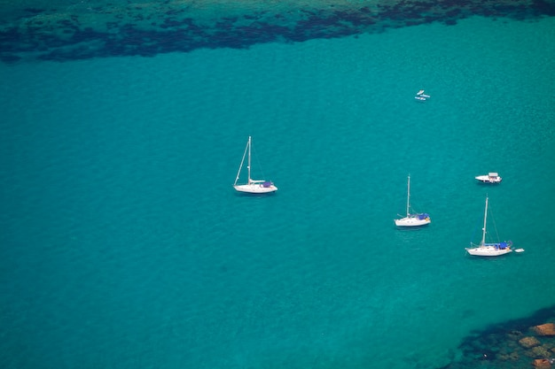 Turquoise sea and white yachts. view from above