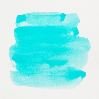 Turquoise watercolor paint on abstract background