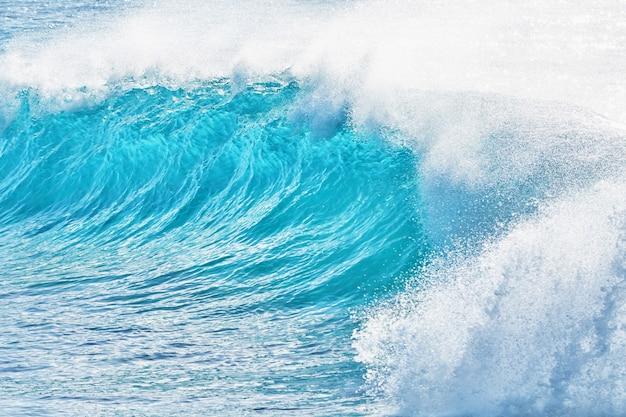 Turquoise waves at sandy beach, hawaii