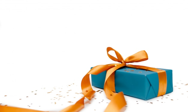 Turquoise wrapping paper with golden ribbon. gift box holiday concept, top horizontal view copyspace