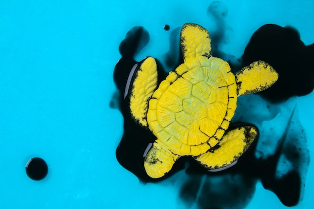 Turtle in oil. pollution in ocean environmental problem. ecological situation world earth
