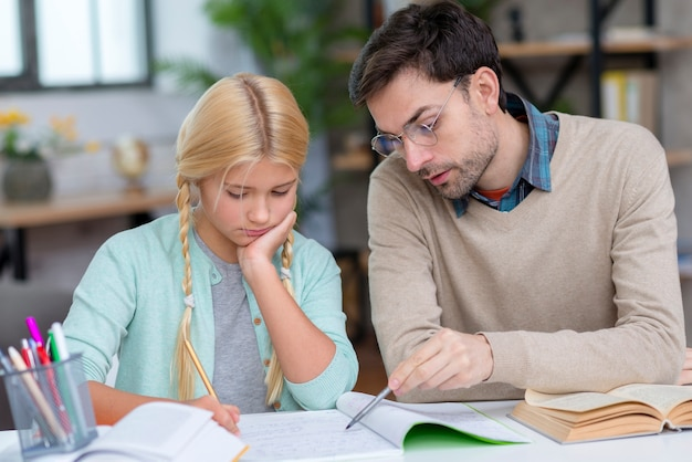 Tutor and girl at home front view