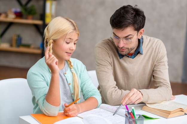 Tutor and girl at home student having an idea