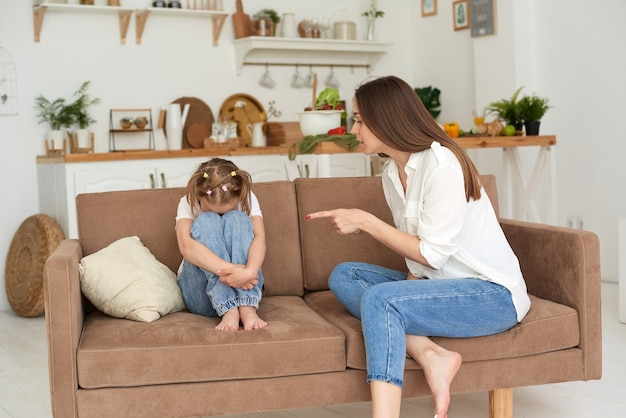 Tutor or mother scolds her daughter for bad behavior or school. family problems.