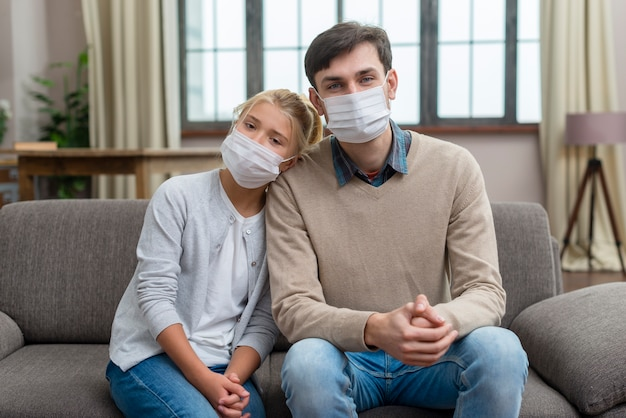 Tutor and young student wearing medical masks