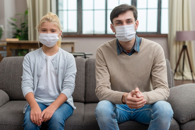 Tutor and young student wearing protection masks