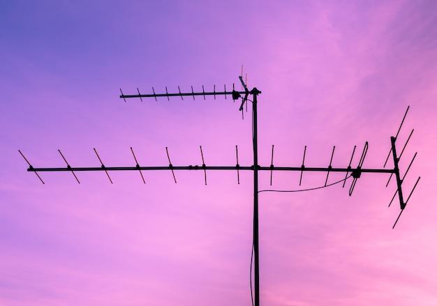Tv antenna at sunrise sky