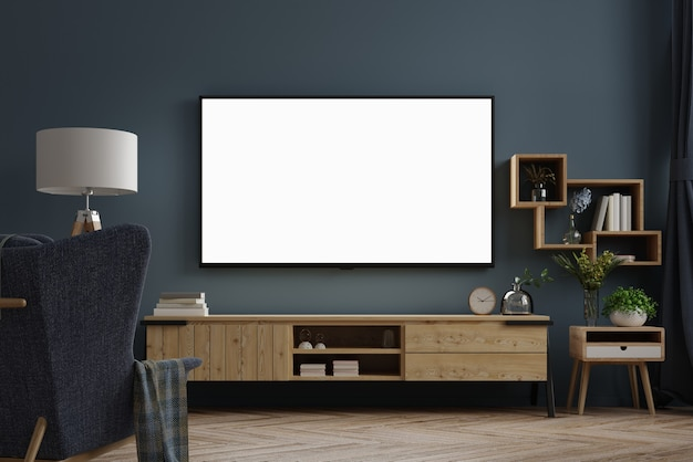 Tv on cabinet in modern empty room at night with behind the dark blue wall.3d rendering