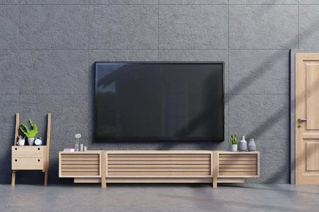 Tv on cabinet in modern empty room with concrete wall and floor