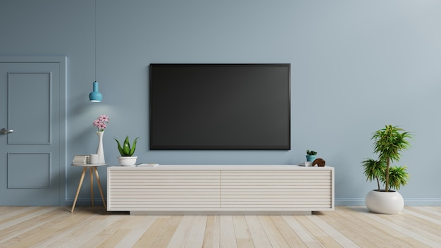 Tv on the cabinet in modern living room on blue wall.