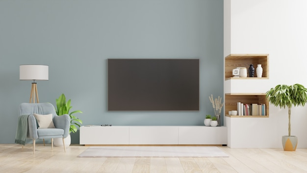 Tv on cabinet in modern living room,interior of a bright living room with armchair on empty blue wall