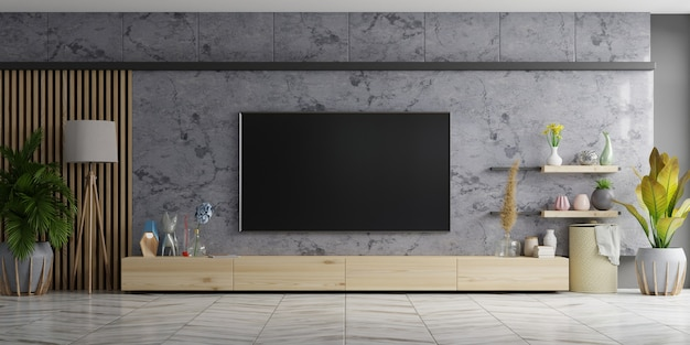 Tv on cabinet the in modern living room the marble wall. 3d rendering