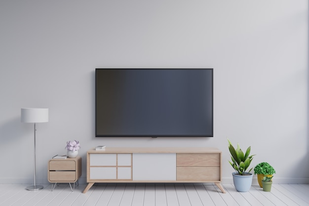 Tv on the cabinet in modern living room with plant on white wall background