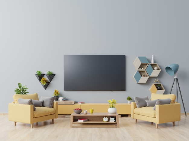 Tv on the cabinet in modern living room with yellow armchair on dark blue wall.