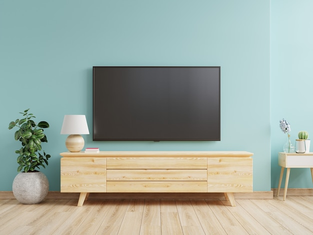 Tv on cabinet mounted in a living room with a blue wall. 3d rendering