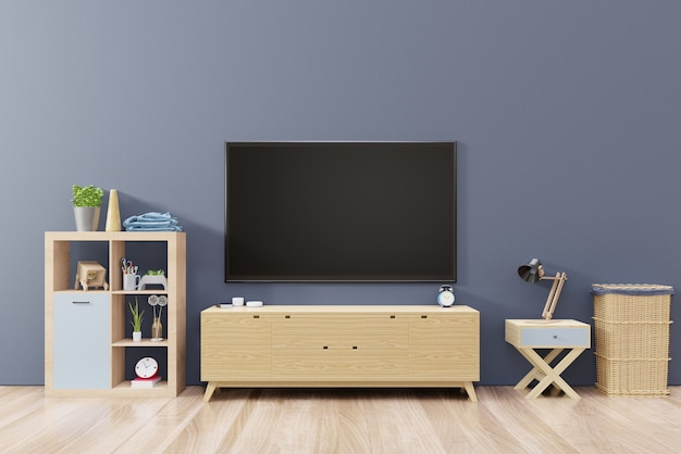 Tv on cabinet with blank screen stick on the dark wall in modern living room