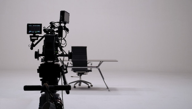 Tv commercial recording and movie camera set and camera man in big studio.