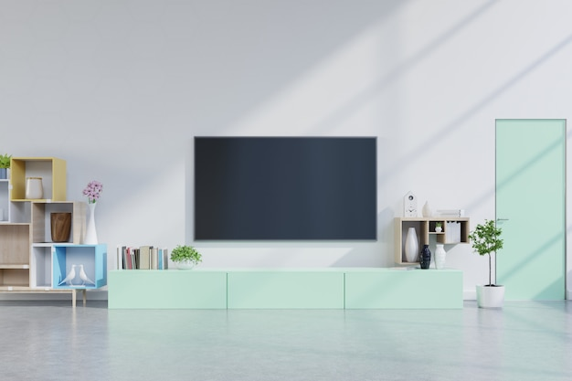 Tv on green cabinet in modern living room with plants in living room with empty white wall.