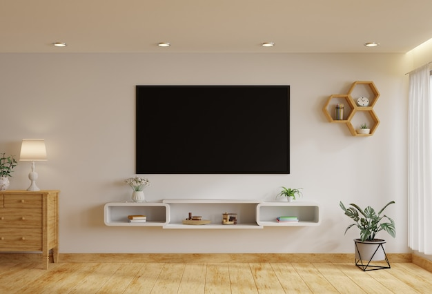 Tv in the living room on a white wall by the window, decorated with plants. 3d rendering.
