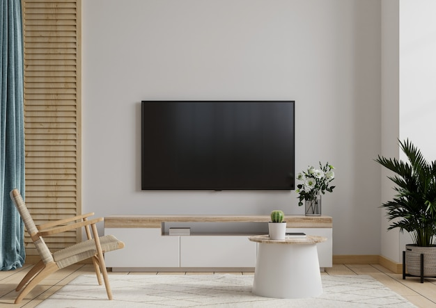 Tv lounge with armchair on white wall