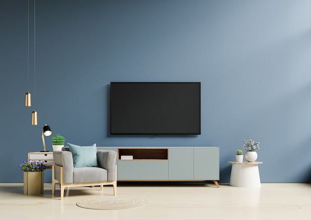 Tv in modern living room with armchair have empty dark blue wall background.3d rendering
