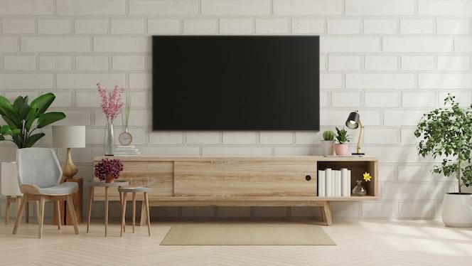 现代客厅的电视,带扶手椅和砖墙上的植物。三维渲染