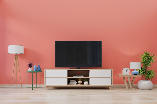 Tv in modern room with decoration on living coral wall background