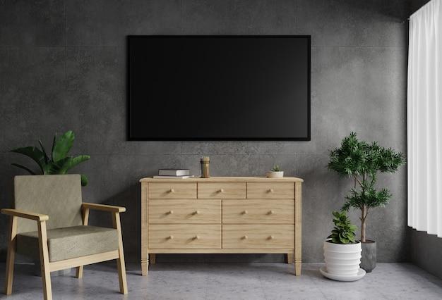 リビングのコンクリートの壁にあるテレビは、木製のテーブルで飾られています。