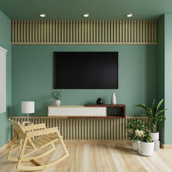 Телевизор на зеленой стене в гостиной с креслом-качалкой и кашпо на полу