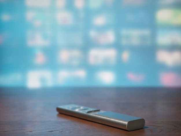 Tv remote control on the background of a tv screen