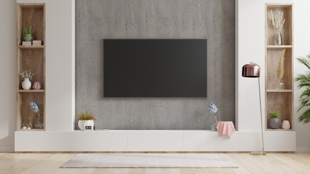 Tv on stand the in modern living room the concrete wall,3d rendering