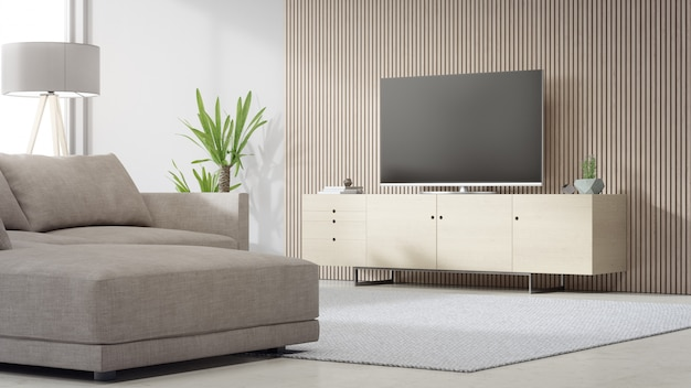 Tv stand near wooden wall of bright living room and sofa against television in modern house or apartment.