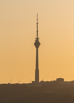 Tv tower in baku city at sunset