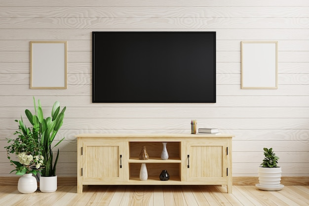 Tv on the white wooden wall in the living room decorated with wooden cabinet and plant pots on the side. 3d rendering.