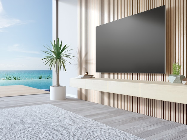 Tv on wooden wall of living room in modern beach house or luxury pool villa