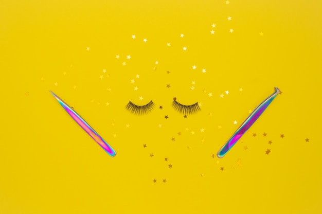 Tweezers for eyelash extension, artificial eyelashes and gold stars