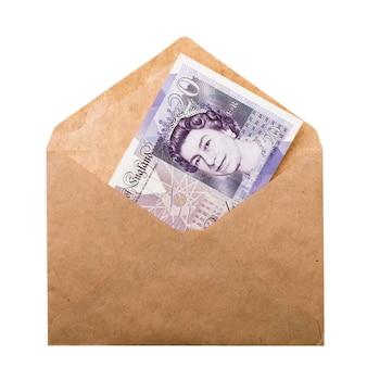 白い背景で隔離の封筒の20ポンド