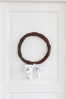 Twig wreath hanging on white
