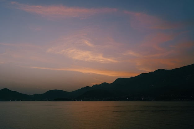 Twilight after sunset over the mountains and the sea