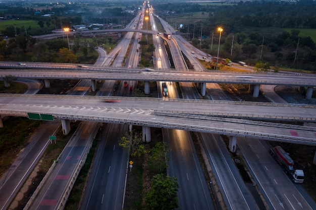 Twilight landscape long exposure movement traffic car on  expressway interchange in thailand