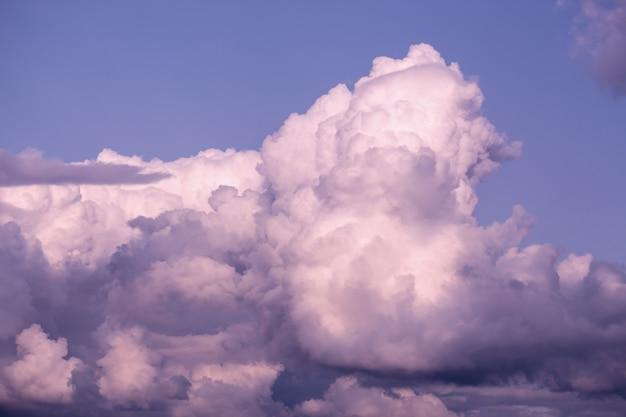 Twilight pink cloud on purple sky.