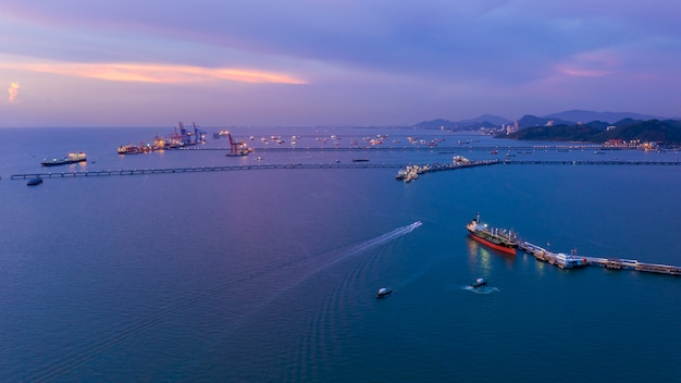 Twilight seascape and shipping port loading oil and gas on the sea