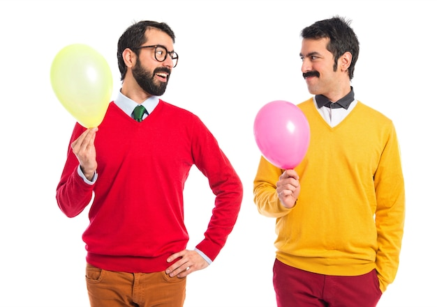 Twin brothers with balloons