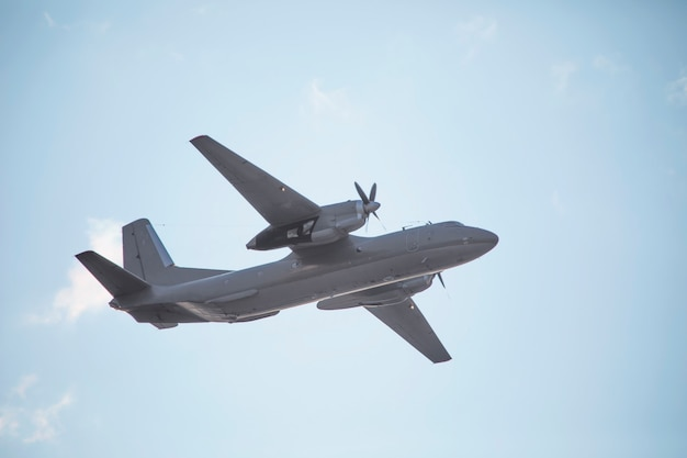 A twin-engine military transport aircraft performs a flight.