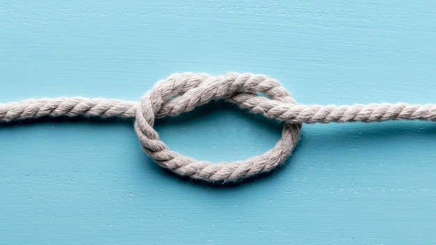 Twine strong white rope with knot flat lay