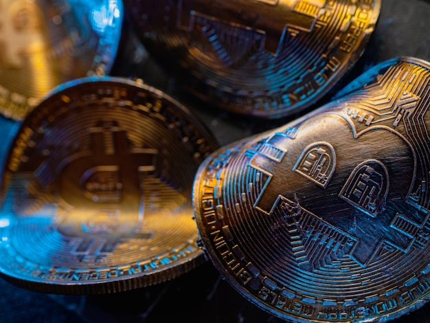 Twisted gold coins with bitcoin symbol. concept of a cryptocurrency market crisis.