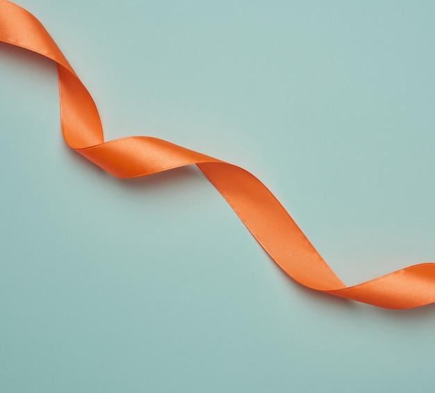 Twisted orange ribbons on blue