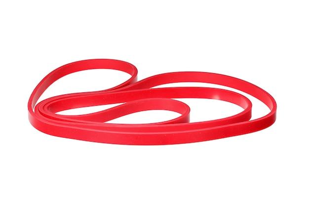 Скрученный красный резиновый браслет, изолированные на белом. макро фото.