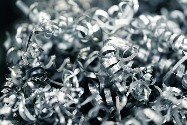 Twisted spiral steel from cnc lathe  machine, close up scrap metal material, industry waste